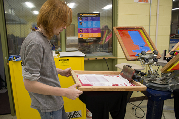 Multimedia student printing T-shirts