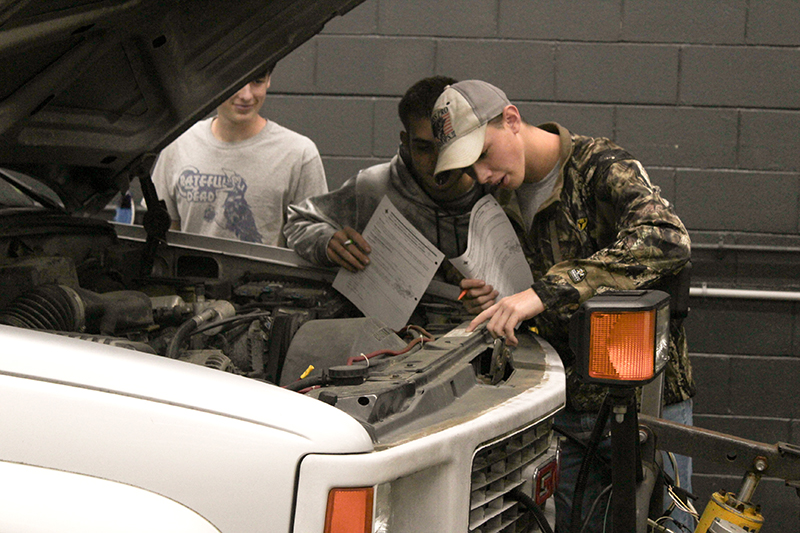 Automotive students working on assignment