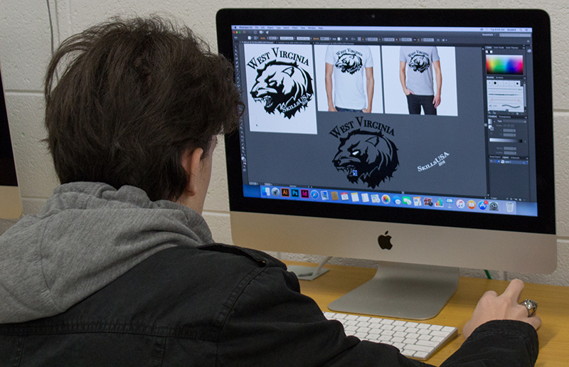 Student working on a t-shirt project.