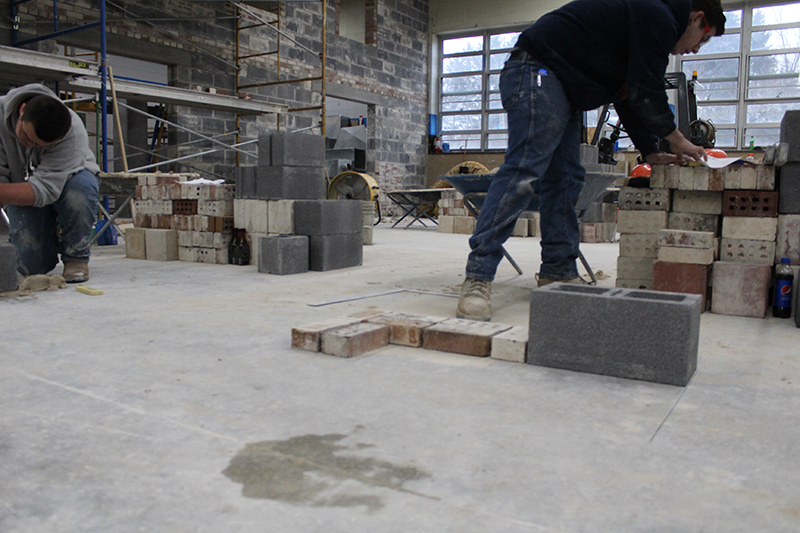 Students working in masonry lab